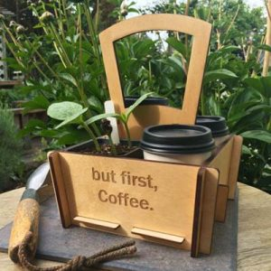 wooden tote box with coffee and plants